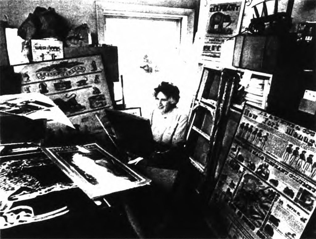 Mabel Addis surrounded by art in a back room of a museum